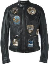 Dolce & Gabbana musical patch leather jacket - men - Silk/Polyester/Polypropylene/Bullhide Leather - 48