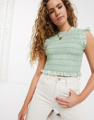 And other stories & smocked linen ruffle hem top in sage green