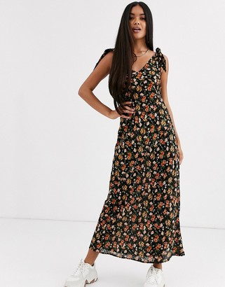 Asos DESIGN bias cut button front maxi dress with wooden rings in floral print
