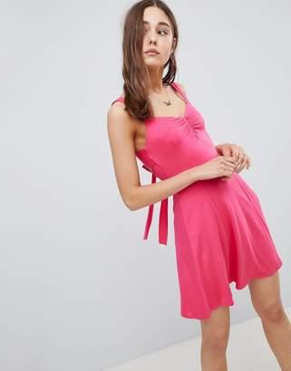 Asos Design DESIGN mini swing sundress with tie back-Pink