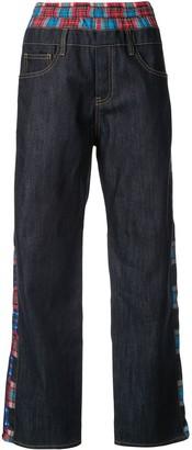 Koché Crazy check print trousers