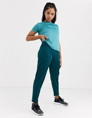 Nike Running track pants in teal blue