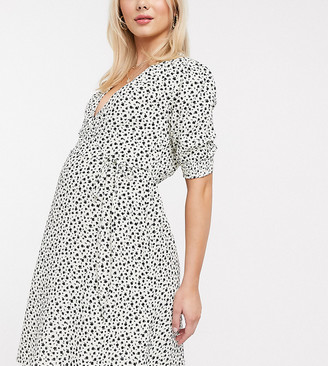New Look Maternity puff sleeve mini wrap dress in black floral