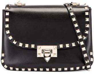 Valentino Small Rockstud Shoulder Bag in Black | FWRD