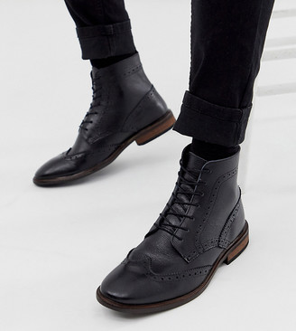 Asos DESIGN Wide Fit brogue boots in black leather with natural sole