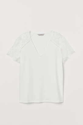 H&M Top with lace sleeves