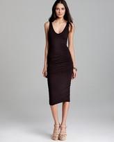 kim kardashian  Who made  Kim Kardashians gray ruched dress, black sunglasses, and gold flat sandals?