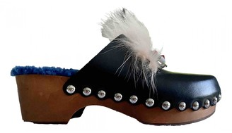 Fendi Black Leather Mules & Clogs