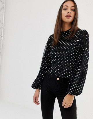 ASOS DESIGN top with blouson sleeve and tie neck in spot mesh print