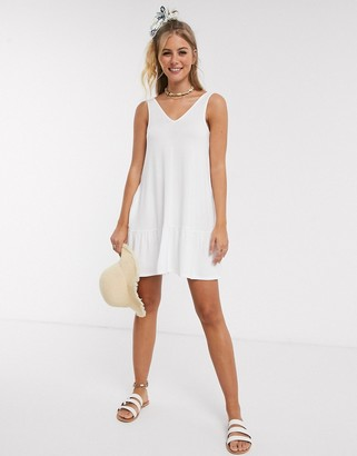 ASOS DESIGN concealed pocket mini dress with tiered hem in white