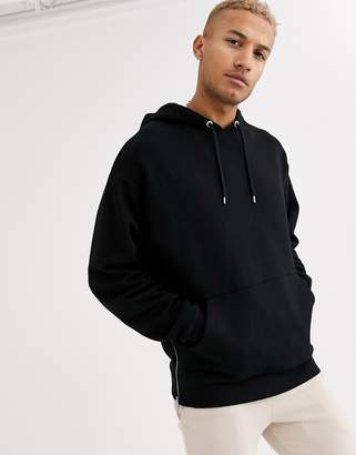 Asos Design DESIGN oversized hoodie in black with silver side zips