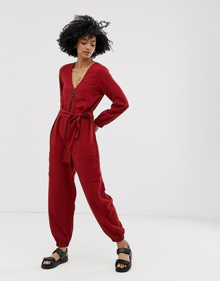 Asos DESIGN zip front tie waist boilersuit with pockets