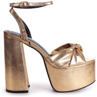 Linzi RUMOUR - Gold Crinkle Metallic Extreme Platform With Bow Front Strap
