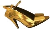 BCBGMAXAZRIA Gold Patent leather Heels