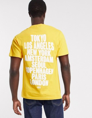 Obey international back print t-shirt in yellow