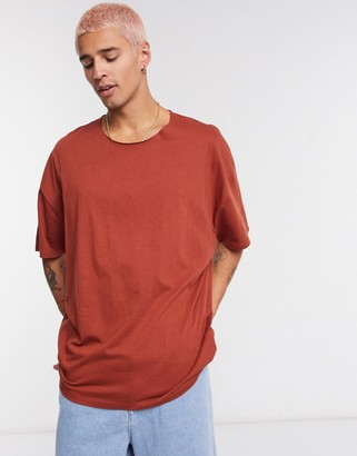 ASOS DESIGN oversized t-shirt with raw neck in brown