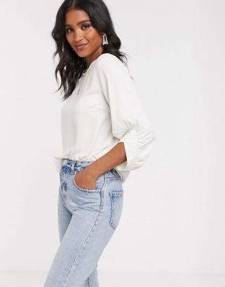 Vero Moda puff sleeve blouse in cream