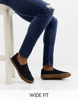 Asos DESIGN Wide Fit slip on plimsolls in black with gum sole
