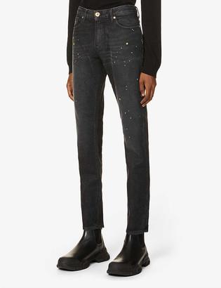 Emporio Armani Paint-splatted slim stretch-denim jeans