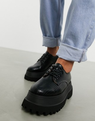 ASOS DESIGN Marcy chunky lace up flat shoes in black lizard