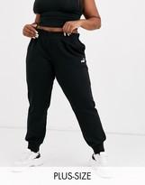 Puma Plus Essentials black sweat pants