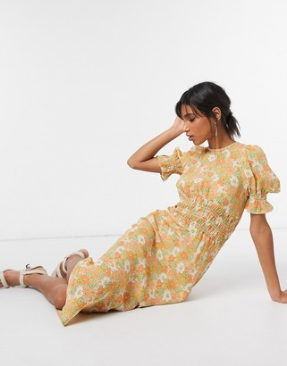 ASOS DESIGN midi tea dress with shirring details in yellow based ditsy floral print