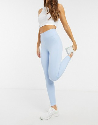 In The Style x Courtney Black activewear ruched booty leggings in blue