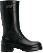 Raf Simons slogan embossed mid-calf boots