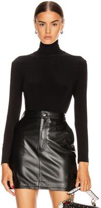 Norma Kamali Long Sleeve Turtleneck Bodysuit in Black | FWRD