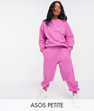ASOS DESIGN Petite tracksuit oversized sweat with wash and embroidered slogan / oversized sweatpants in pink