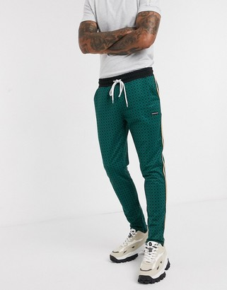 Good For Nothing geo hounds pant with satin taping in green