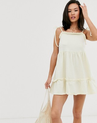 ASOS DESIGN textured cami strappy sundress with tiered hem in textured yellow stipe