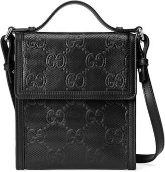 Gucci embossed GG motif messenger bag
