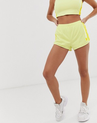adidas adicolor three stripe shorts in neon yellow