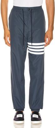 Thom Browne Track Pants in Navy   FWRD