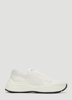 Prada Logo Embossed Sneakers