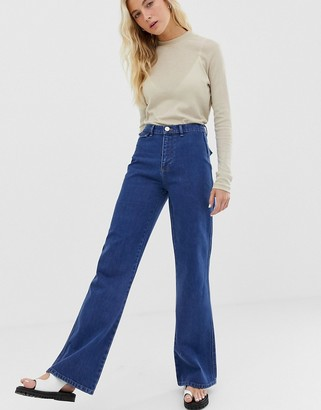 Asos Design DESIGN Full length flare jeans with pressed crease and western pockets in mid vintage wash-Blue