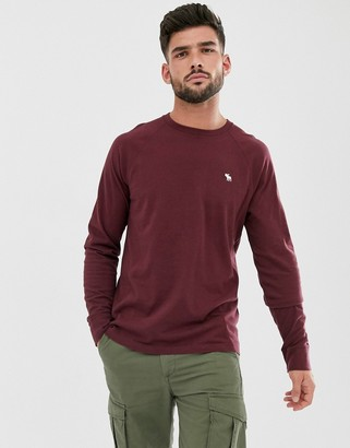 Abercrombie & Fitch icon logo long sleeve top in burgundy-Red