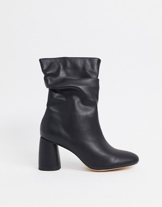 Public Desire Marshmallow slouch boots in black