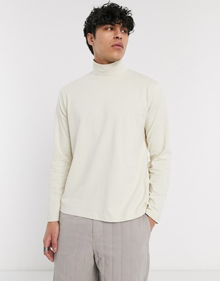 ASOS loose fit long sleeve t-shirt with turtle neck in beige