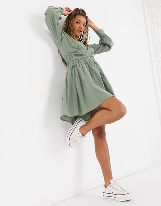 ASOS DESIGN crinkle button through mini tea dress with ruched waist in khaki