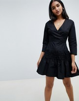 Asos Design DESIGN cotton wrap front mini dress with shirred skirt