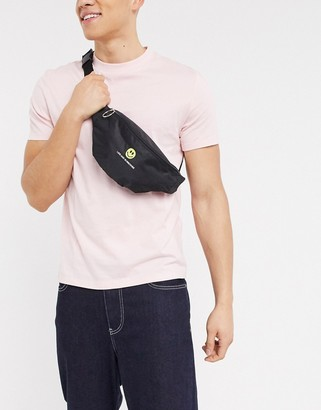 Asos DESIGN cross body fanny pack in black with embroidery
