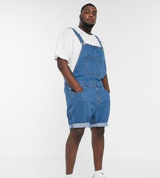 Asos DESIGN Plus denim overall shorts in mid wash