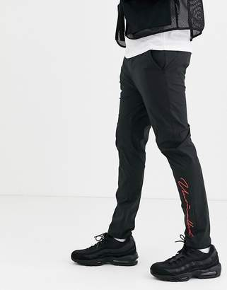 Design DESIGN skinny trousers with text print in black nylon