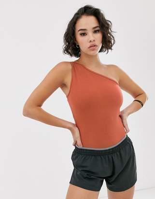 Nike Training yoga one shoulder bodysuit in rust-Orange