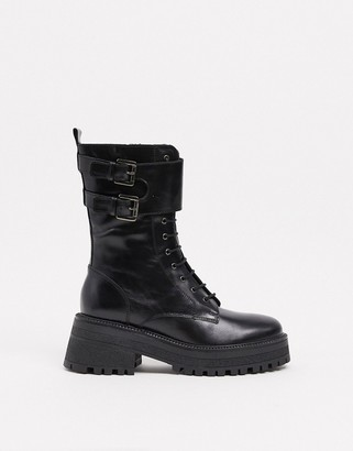 Schuh Asher lace-up mid-heeled ankle boot with buckles in black leather