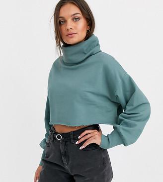 Asos DESIGN Petite crop sweatshirt with slouchy roll neck in teal