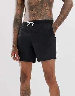 Asos Design DESIGN swim shorts in black mid length