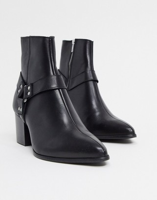 Asos DESIGN heeled chelsea boots with pointed toe in black leather with strap detail